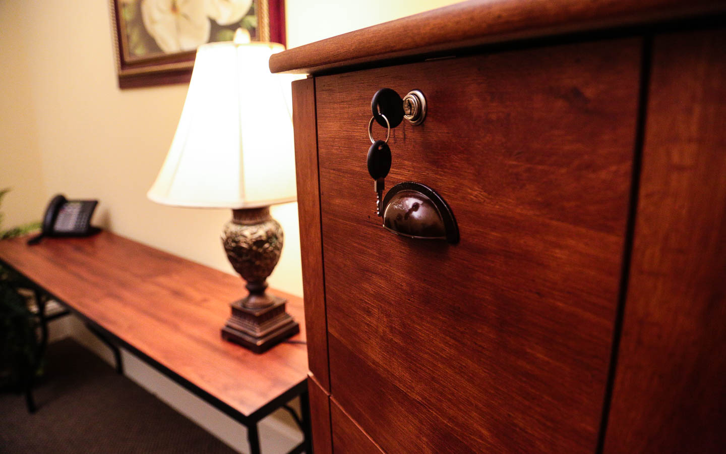 locked file cabinet overlooking desk space